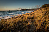 Brissons and Cape Cornwal in the far distance in the late afternoon, Sennen Beach, Sennen, Cornwall, England, United Kingdom, Europe