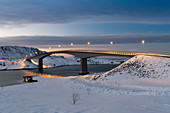 Fredvang Bridge at night in winter with covering of snow, Lofoten, Arctic, Norway, Europe