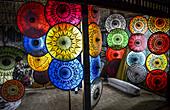 Brightly coloured traditional umbrellas in Bangar, Myanmar.