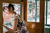 Young Chinese Woman in old tram, Shanghai, China