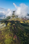 France, Puy de Dome, area listed as World Heritage by UNESCO, Orcines, Chaine des Puys, Regional Natural Park of the Auvergne Volcanoes, the Puy de Dome in the clouds (aerial view)