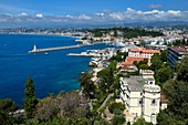 France, Alpes Maritimes, Nice, the Baie des Anges, the port entrance and the Villa La Cote (the Coast) that houses the administrative tribunal in the foreground