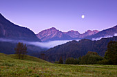 Morning mood with waning moon, Allgäu Alps, near Oberstdorf, Allgäu, Bavaria, Germany