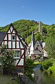 View over the Elzbach and the half-timbered houses to Phillipsburg, Monreal, Eifel, Rhineland-Palatinate, Germany
