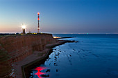 Lummenfelsen and lighthouse on the Oberland, Helgoland, North Sea, Schleswig-Holstein, Germany