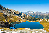 Blue sky is reflected in the lake. Swiss mountains. Lai da Rims. Switzerland. Graubünden, Europe