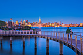 Manhattan, Lower Manhattan and World Trade Center, Freedom Tower in New York across Hudson River from Pier C Park, Hoboken, New Jersey, United States of America, North America