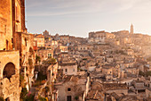 View over Sasso Caveoso to the cathedral at sunrise, UNESCO World Heritage Site, Matera, Basilicata, Puglia, Italy, Europe
