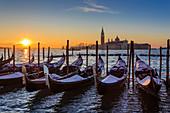 Venetian winter sunrise after snow with gondolas, San Giorgio Maggiore and Lido, Venice, UNESCO World Heritage Site, Veneto, Italy, Europe
