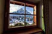 View of Sass De Putia surrounded by snowy woods from the window, Passo Delle Erbe, Funes Valley, South Tyrol, Italy, Europe