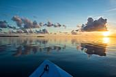 Sunset over the calm waters of Tikehau, Tuamotus, French Polynesia, Pacific