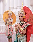 Portrait of two dancers in traditional Thai classical dance costume, smiling and looking at the camera, Bangkok, Thailand, Southeast Asia, Asia