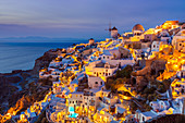 Windmill and traditional houses after sunset, Oia, Santorini (Thira), Cyclades Islands, Greek Islands, Greece, Europe