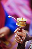 Prayer wheels being spun by a pilgrims at the National Memorial Chorten, Thimphu, Bhutan, Asia