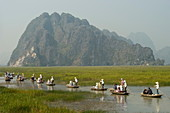 Punting boats on delta river, limestone mountain scenery, Van Long, Ninh Binh, south of Hanoi, North Vietnam, Southeast Asia, Asia