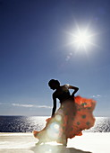 Flamenco dancing by sea in full sunlight, Ibiza, Spain, Europe