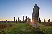 The sun rises at Callanish stone circle, Isle of Lewis, Outer Hebrides, Scotland, United Kingdom, Europe