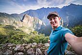 Tourists exploring Machu Picchu Inca Ruins, Cusco Region, Peru, South America