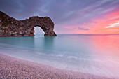 A colourful sunset over Durdle Door on the Jurassic Coast, UNESCO World Heritage Site, Dorset, England, United Kingdom, Europe