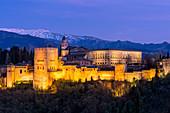 The Alhambra Palace illuminated at dusk, UNESCO World Heritage Site, Granada, Andalucia, Spain, Europe