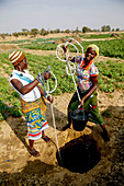 Women fetching water in Namong, Tone district, Togo, West Africa, Africa