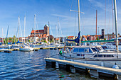 Old town of Wismar viewed from the marina located beside Stockholmer Strasse, St. Nikolai gothic church, Wismar stadt, Mecklenburg–Vorpommern, Germany.