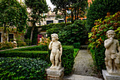 Garden with putti in Venice, Italy