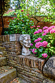 Bust in a garden in Venice, Italy