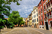 Wide square with colorful house facades in the San Polo district, Venice, ItalyVenice, Italy