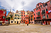 Square with red houses, Venice, Italy