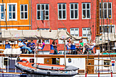 Cafe at the desk of a ship. Nyhavn (New Harbour), 17th-century waterfront, canal and entertainment district in Copenhagen, Denmark