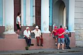 Men talking on the street of Cienfuegos, Cuba