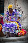 Cuban woman in traditional dress, Havana, Cuba