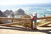 Child looks out to sea from Big Sur. California, United States