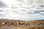 View of the ghost town of Bodie under a cloudy sky in the Eastern Sierra, California, USA.