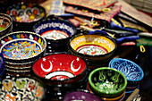 Colorful ceramic bowls for sale in the Grand Bazaar, Capali Carsi, in Istanbul, Turkey