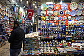 Knick-knack stand with plates, cups, pendants and other tourist items in the Grand Bazaar, Capali Carsi, in Istanbul, Turkey