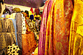 Fabrics for sale in the Grand Bazaar, Capali Carsi, in Istanbul, Turkey