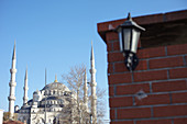 House corner with the blue mosque in the background in Istanbul, Turkey