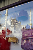 Reflection of the blue mosque in a shop window in Istanbul, Turkey
