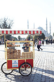 Pastry vendors in the forecourt of the Blue Mosque in Istanbul, Turkey