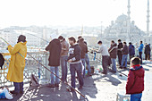 Fishermen on the Galata Bridge in Istanbul, Turkey.