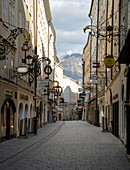 View of the empty Getreidegasse with Gaisberg in the background in Salzburg, Austria.