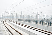 Railroad tracks and electricity pylons of the newly built South Railway Station, Guangzhou, Guangdong Province, China