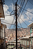 Power cable tangle on electricity pylons in old town La Paz, Bolivia, Andes, South America