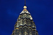 Partial view of the Petronas Towers in Kuala Lumpur, Malaysia, at the blue hour just before nightfall