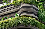 Facade greenery and unusual architecture of a skyscraper in Singapore