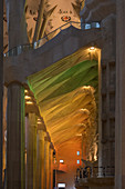 Colorfully lit corridor in the Sagrada Familia, the cathedral of Gaudi in Barcelona, Spain