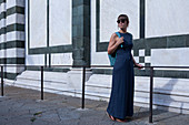 Woman in dress on facade of San Giovanni Baptistery in Florence, Tuscany Italy