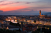 Florence skyline with Ponte Vecchio bridge and Torre di Arnolfo tower at sunset, Tuscany Italy